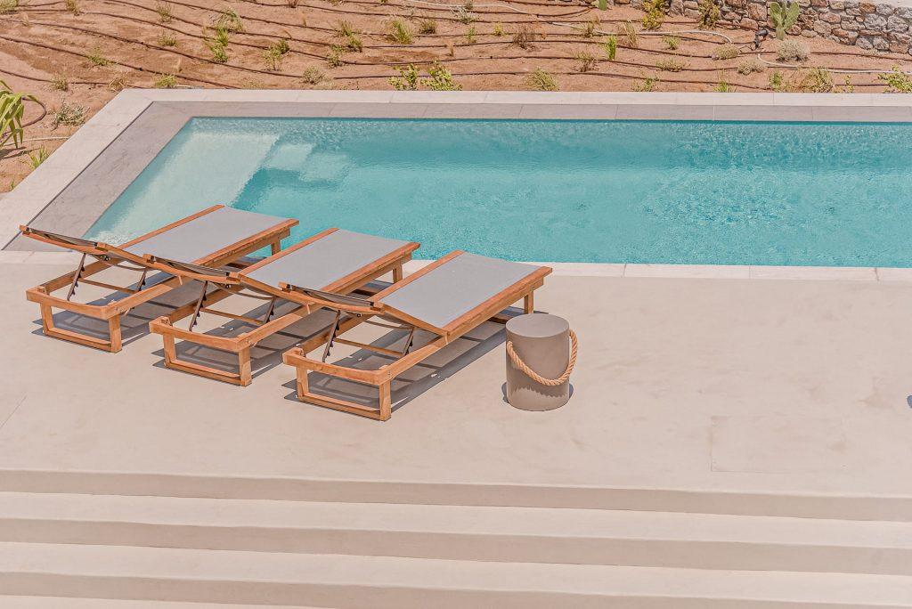 Sun beds by the villa Astrea private outdoor pool. A luxury private pool villa in Ftelia, Mykonos.