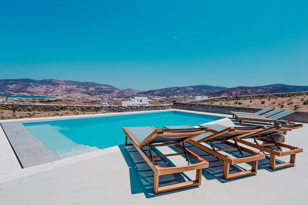 The villa Astrea, private pool with sun beds and view. A luxury private pool villa in Ftelia, Mykonos.