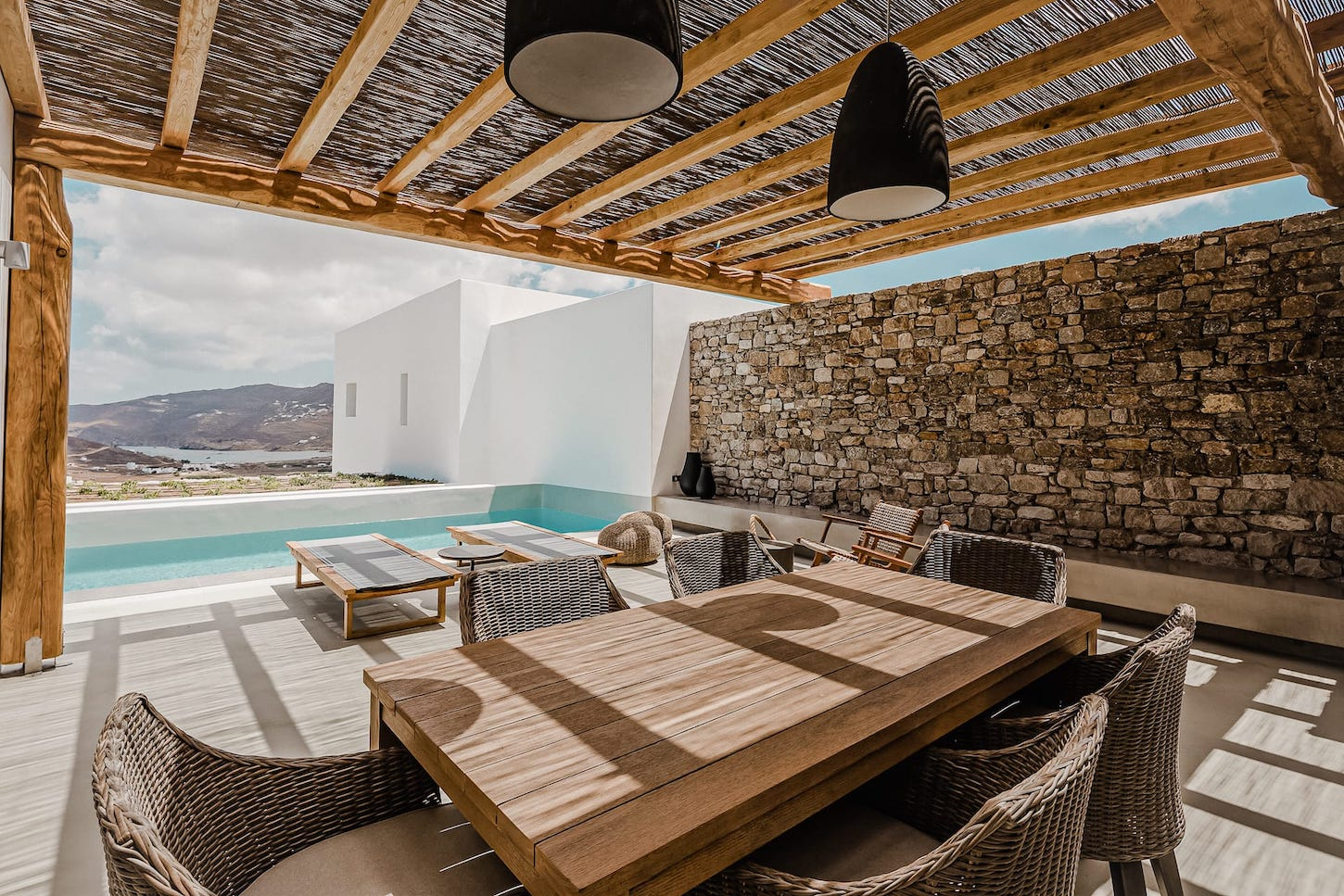 The villa Iris private terrace with table and chairs. A 1 bedroom luxury villa in Ftelia, Mykonos.
