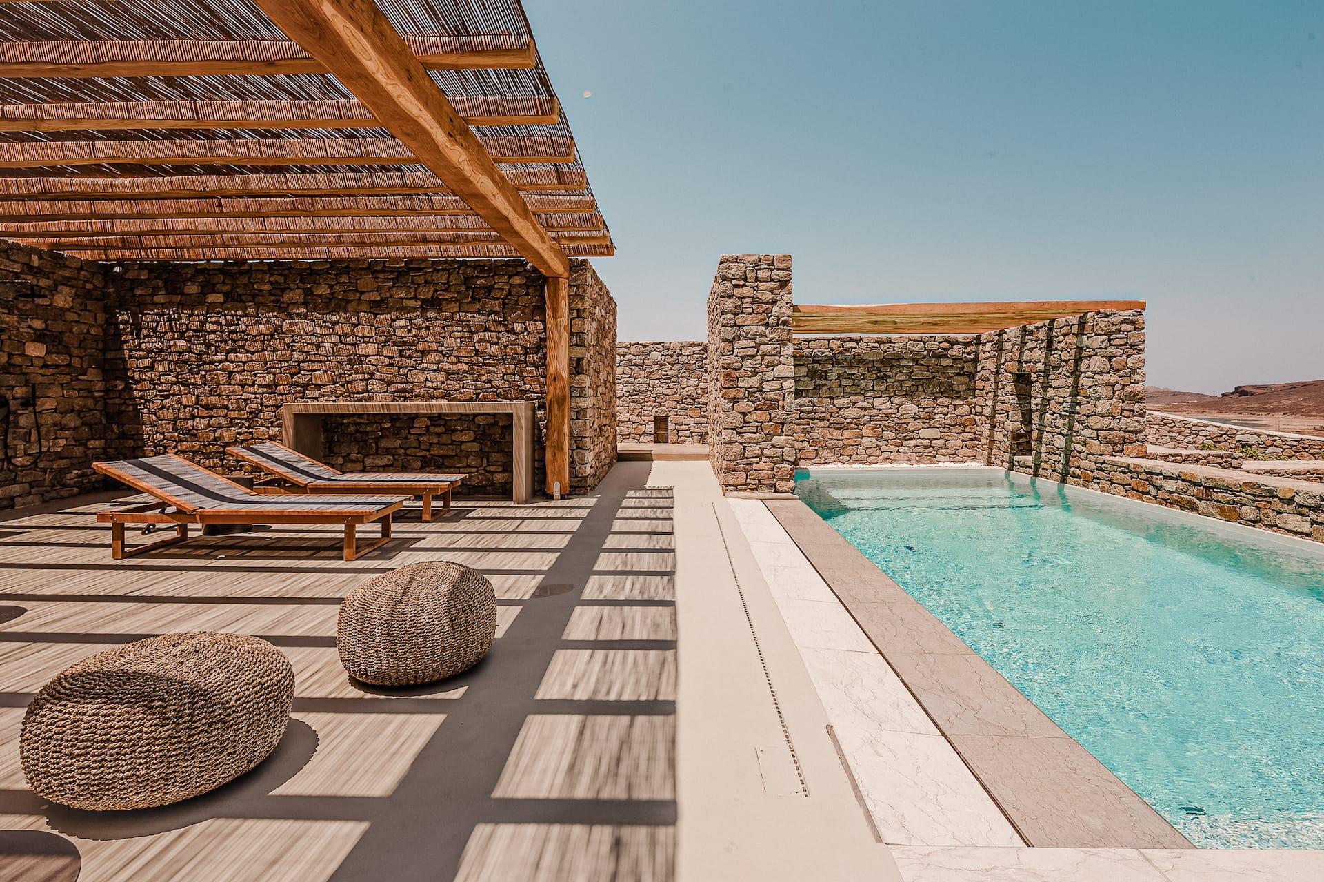 The villa Lito private outdoor pool & terrace with sunbeds. A luxury villa in Ftelia, Mykonos.