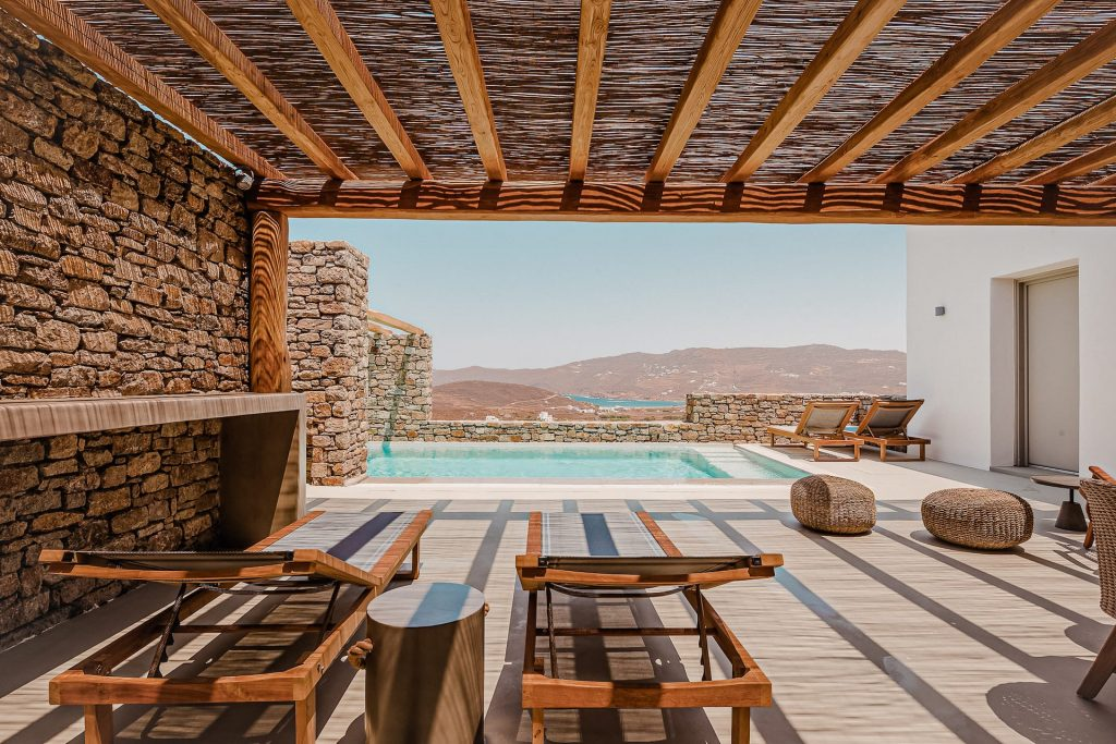 The villa Lito, private terrace with sunbeds and pool view. A luxury pool villa in Ftelia, Mykonos.