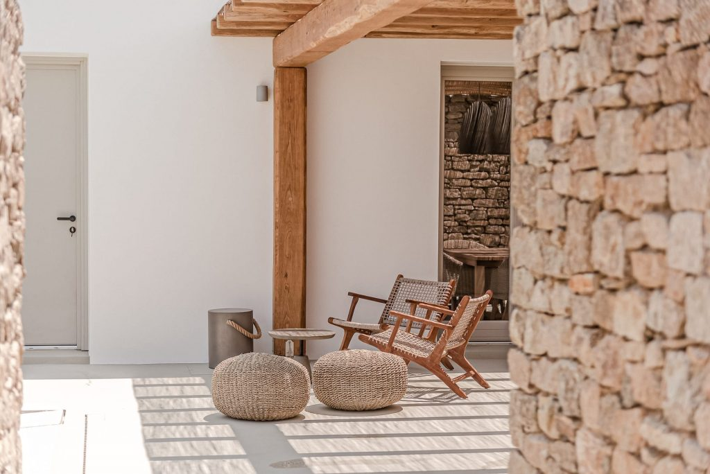 The villa Lito, private terrace with table and chairs. A luxury pool villa in Ftelia, Mykonos.
